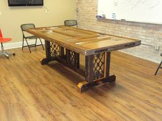 Conference Table - reclaimed pocket door with original hardware used as the tabletop