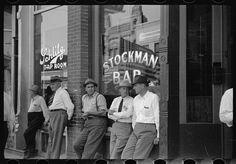 Stockmen in front of bar on main street, Miles City, Montana