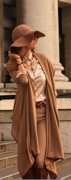 Lose the floppy hat - the camel coat over breeches & brown leather steals the show.