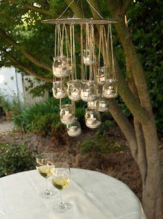 Garden lighting: am so doing this above the table out the back as a chandelier! Cheap as too! Could just use a cooling rack!