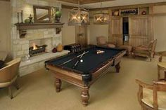 Basement billiard room.  The doors in the back corner lead to an exercise room.