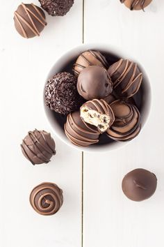 Cookie Dough Truffles - Perfectly poppable bites of cookie dough dipped in chocolate. Eggless and no bake. | http://livforcake.com