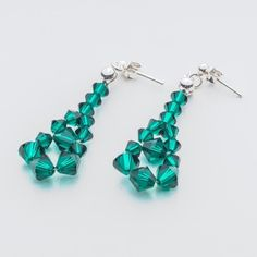 Swarovski Bicone Earrings 45mm Emerald  Dimensions: length: 4,5cm stone size: 4 and 6mm Weight ( silver) ~ 0,90g ( 1 pair ) Weight ( silver + stones) ~ 3,90g Metal : sterling silver ( AG-925) Stones: Swarovski Elements 5328 4 & 6mm Colour: Emerald 1 package = 1 pair  Price 7 EUR