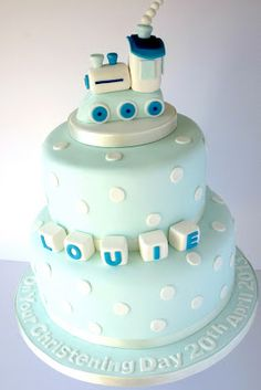 My sugar coated life...: Blue spotty train topped christening cake with name blocks via Star Bakery http://www.starbakery.co.uk/
