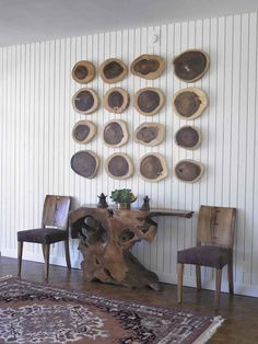 that table and the wood slabs as art on the wall behind it.
