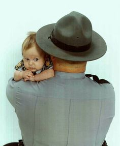 12/03- My PA State Police Trooper hubby w. our 4 mo baby son.