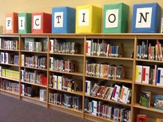 Children's Library Shelving - Collection separated by large, distinct letter signage helping children to more easily locate materials and understand library organization. Signage also helps young children with letter recognition. School Library Decor, School Library Displays, Middle School Libraries, Elementary School Library, Elementary Schools, Library Ideas, Elementary Library Decorations, Library Rules, School Library Lessons