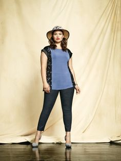 Plus size model Tara Lynn wearing a top with print inserts and a slim leg blue pant. Available at Addition Elle, your plus size destination. #plussize