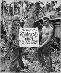 """The U.S. Marines salute the U.S. Coast Guard after the fury of battle had subsided and the Japanese on Guam had been defeated. """"They (the Coast Guard) Put Us Here and We Intend to Stay"""" is the way the Marines felt about it., ca. 08/1944. by The U.S. National Archives, via Flickr ~ World War II"""