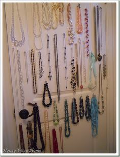 More jewelry organization ideas... using command strips on the back of closet door to keep all your necklaces organized at a glance!