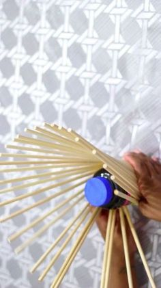 Twist dowels around a bottle for a simple & gorgeous tabletop idea