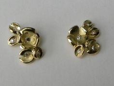 oorbellen gemaakt met goud van klant en steentjes van klant.
