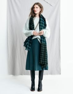 madewell fall 2015 #fallmadewell. mint sweater, dark green knee-length skirt, knee-high black leather boots, long plaid scarf.