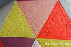 Triangle quilting with various size circles and dot to dot straight lines by Sometimes quilter