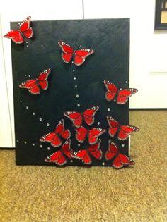 Super Easy DIY Art: black canvas + hot glue gun + fake butterflies