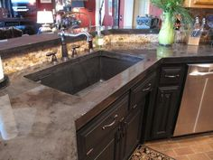 Kitchen concrete countertops Charcoal stain Epoxy finish - DIY tutorial at  http://leavingourtrail.wordpress.com/2013/07/22/how-to-pour-and-install-concrete-countertops-in-your-kitchen/