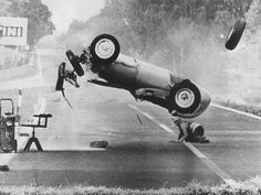That's Hans Hermann crouched down there, underneath the flipping car- the flipping car that, until just moments before this photo was taken, he was piloting. The crash, at the 1959 AVUS F1 race, was caused by failure of the brakes on Hermann's BRM. Amazingly, he walked away from the accident with only minor bumps and bruises.