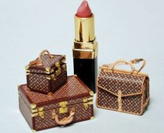 Bags and boxes in 1/12 scale miniature. I love the use of a lipstick to show the scale of these.