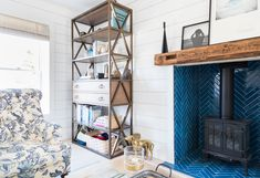 They were hoping to install a wood-burning fireplace, but adding a chimney that would have been approved by the village would have cost more than $40,000--not in budget. The gas burner was a compromise, but a gorgeous one the couple is happy with.