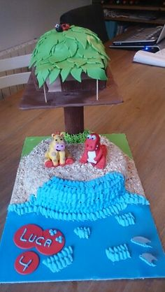 A treehouse cake on the beach, on request with a red crocodile