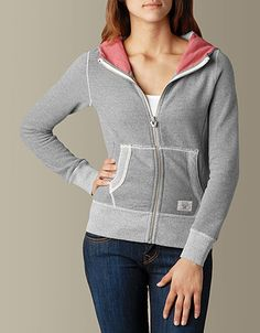 Spring has arrived in this colorful creation by True Religion. A vintage hoodie gets a makeover with a colorblock pattern at the hood and tonal trim...