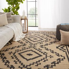 The globally inspired Bedouin collection features an assortment of Southwestern styles that are designed for the contemporary home. The handwoven Jaima rug offers a fresh take on a bold and open tribal medallion in easy-to-decorate colors of light beige and deep black. Crafted of durable and texture-rich jute, this natural, flatweave rug grounds spaces and adds a worldly vibe to any room.