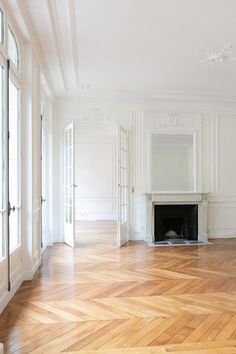 French living room, herringbone wood floors.