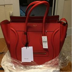 "100% Authentic Celine ""Mini"" Luggage Tote Practically Brand-New worn for less than an hour: 100% Authentic Celine Mini Luggage Tote: Color Red. Purchase at Barneys New York. In excellent condition there are no flaws at all. Tags is not attached anymore they are located inside the bag pocket. Box/Receipt is not included. Not a smoke free  Celine Bags Totes"