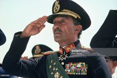 President Anwar Sadat of Egypt at a military review parade shortly before he was assassinated by soldiers in the parade.