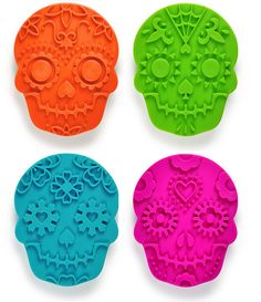 Sweet Spirits Day of the Dead Cookie Stamps are cookie cutters on one side, with a detailed, smiling skull face stamp in one of four assorted designs on the other.    Via Fred Sweet Spirits Cookie Stamps SWSP