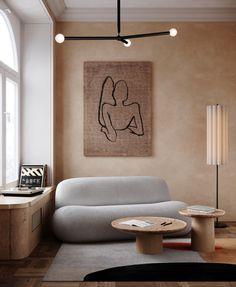 Le tadelakt offre à ce coin salon une douceur apaisante, qui fait écho aux formes arrondies du canapé. Le mobilier en bois blond apporte quant à lui une agréable chaleur. Tadelakt, Blond, Home Decor, Cement Render, The Heat, Big Windows, Sitting Area, Tree Furniture, Decoration Home