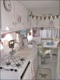 Love the shabby chic treatment on the cabinets. And, the white!!!