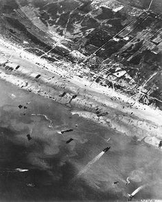 D-Day: The Normandy Invasion Army Air Corps photographers documented D-Day beach traffic as photographed from a Ninth Air Force bomber on June 6 Note vehicle lanes leading away from the landing areas and landing craft left aground by the tide. Nagasaki, Hiroshima, D Day Photos, Old Photos, Antique Photos, World History, World War Ii, History Online, D Day Normandy