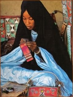 "Africa | Tuareg woman decorating leather. Hoggar, Algeria | Image taken from ""Maghreb: Artisan de la terre"". Text, Jamal Bellakhdar, Photos by Cécile Tréal et Jean-Michel Ruiz."