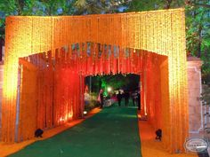 The marigold-bedecked entrance to the wedding at Loharu House. #CoxandKings