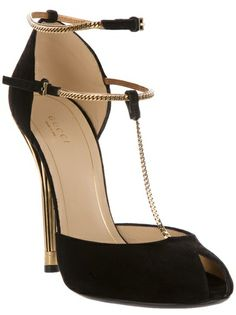 Oh my gaah! Love these!  Black leather pump from Gucci featuring a peep toe, a small link gold-tone chain t-bar strap, a leather sole, a gold-tone stiletto heel, and a double gold-tone ankle strap with buckle fastenings.