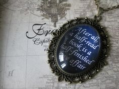 "My favourite Cloud Atlas quote. ""After all, a half-read book is a half-finished love affair...""    Cloud Atlas Cabochon Quote Necklace (David Mitchell). $23.38, via Etsy."
