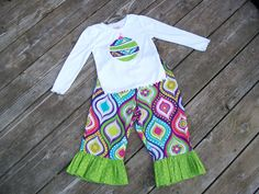 Girl's Ruffle Pant and Long Sleeve Shirt Outfit - Bold Pink Purple and Green Flowers with Personalized Christmas Tree or Ornament Shirt. $32.00, via Etsy.