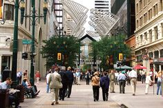 One of the busiest spots during the Calgary Stampede? It has to be historic Stephen Avenue Walk Ave.) - aside from the fairgrounds, of course. O Canada, Alberta Canada, Oh The Places You'll Go, Places Ive Been, Island Park, Travel Around Europe, Western Canada, Calgary, Fun Time