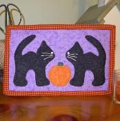 Black Cats Halloween Mug Rug - via @Craftsy