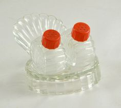 New to ChicMouseVintage on Etsy: Mini Salt Pepper Shakers  w/ Turkey Tail or Clam Shell Tray - Vintage 1940s Glass Red Plastic Caps (15.00 USD)