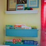 fabric bookshelf combined with photo ledge - love it!