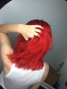 Bright red hair color by Alex at the lab a salon San Diego