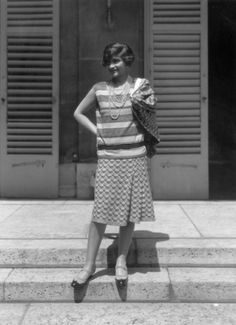 Coco Chanel wears an ensemble of her signature jersey at home in Paris, 1929.