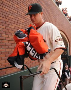Matt Cain brings in the 2012 World Champion flag up during the #SFGiants Opening Day Ceremony