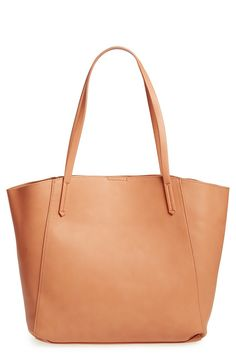 Toting summer essentials in this roomy, neutral-colored tote.