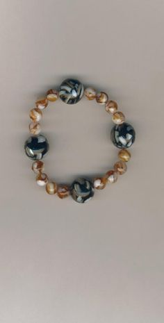 Mother of Pearl Beaded Stretch Cord Bracelet. I support Military families. Looking to buy something special for a lady in the Military or family member in the Military? I offer top-quality jewellery. CHEAPLY-PRICED. FREE NECKLACE GIFT with every purchase. The more items you buy the more free necklace gifts you receive. Visit my online shop and I'll start taking your orders: https://www.etsy.com/ca/shop/JehovahJJewellery?ref=si_shop