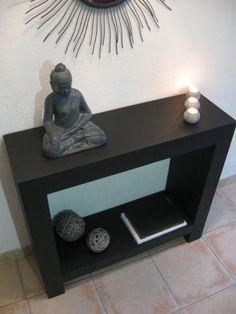 Base d'une cheminée en carton (avec commode en bois moins l'étagère du milieu)