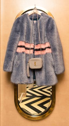 Inside Finery Founder Whitney Casey's Closet: When someone has as much energy and personality as Casey does, they usually have a wardrobe to match, which was exactly the case when we finally dug into the goods in her bedroom-sized-by-NYC-standards closet. -- Gray and Pink Stripe Fur Coat     coveteur.com