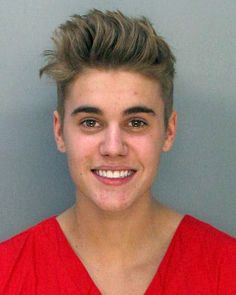 Justin Bieber-Smiling in his mug shot!  Who does that??